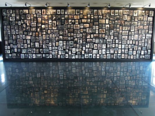 A wall made of small pictures, which were found in the belongings of the Auschwitz victims