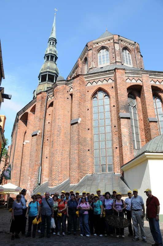 A group standing in front of the huge St. Peter church in Riga, Latvia