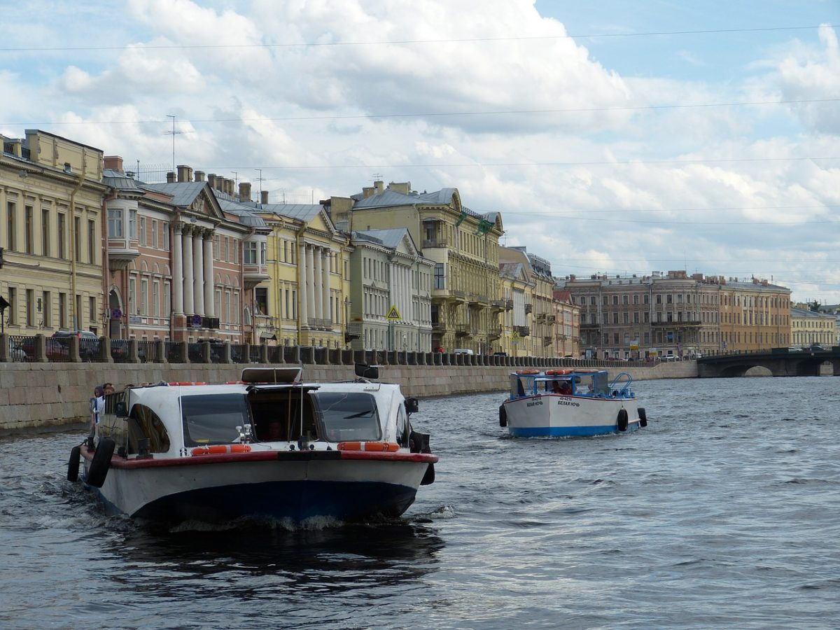 two sightseeing boats on sankt-petersburg-canals