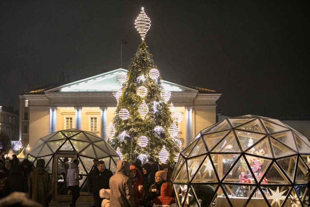 glass tents on Vilnius city hall square in Winter