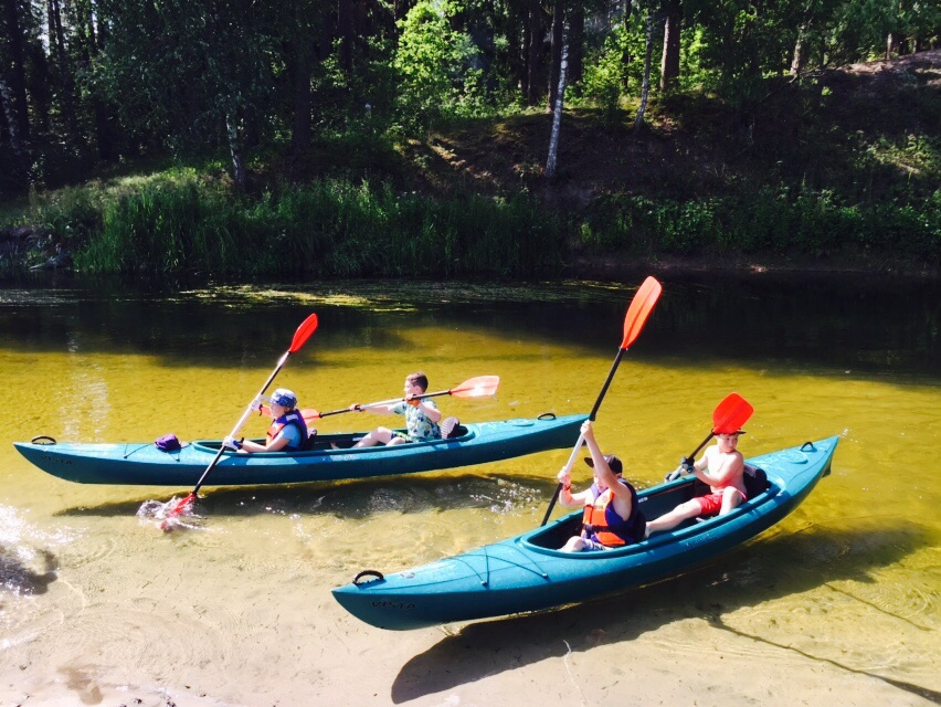 two kayaks with kids