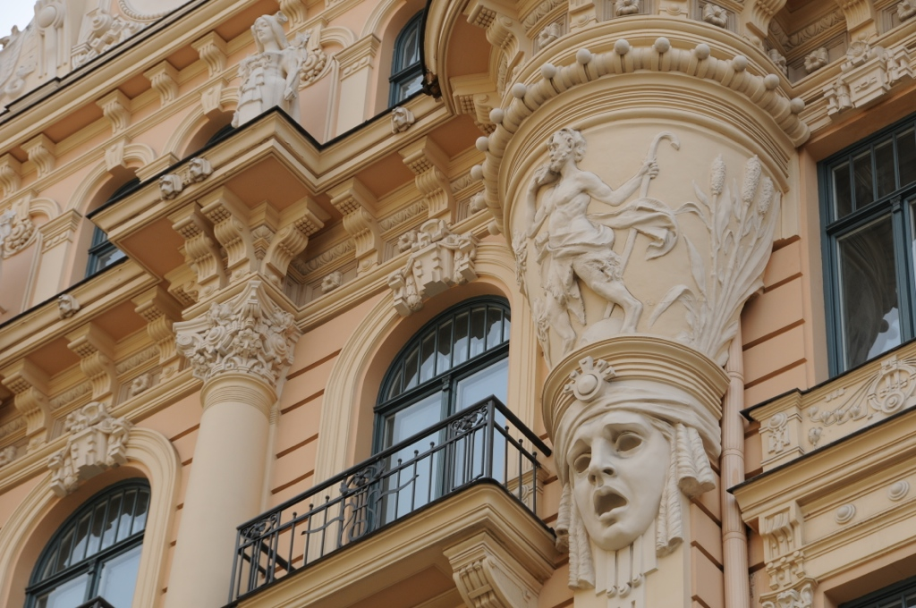 Theatre mask as a decoration of the facade of the building in Art Nouveau in Riga