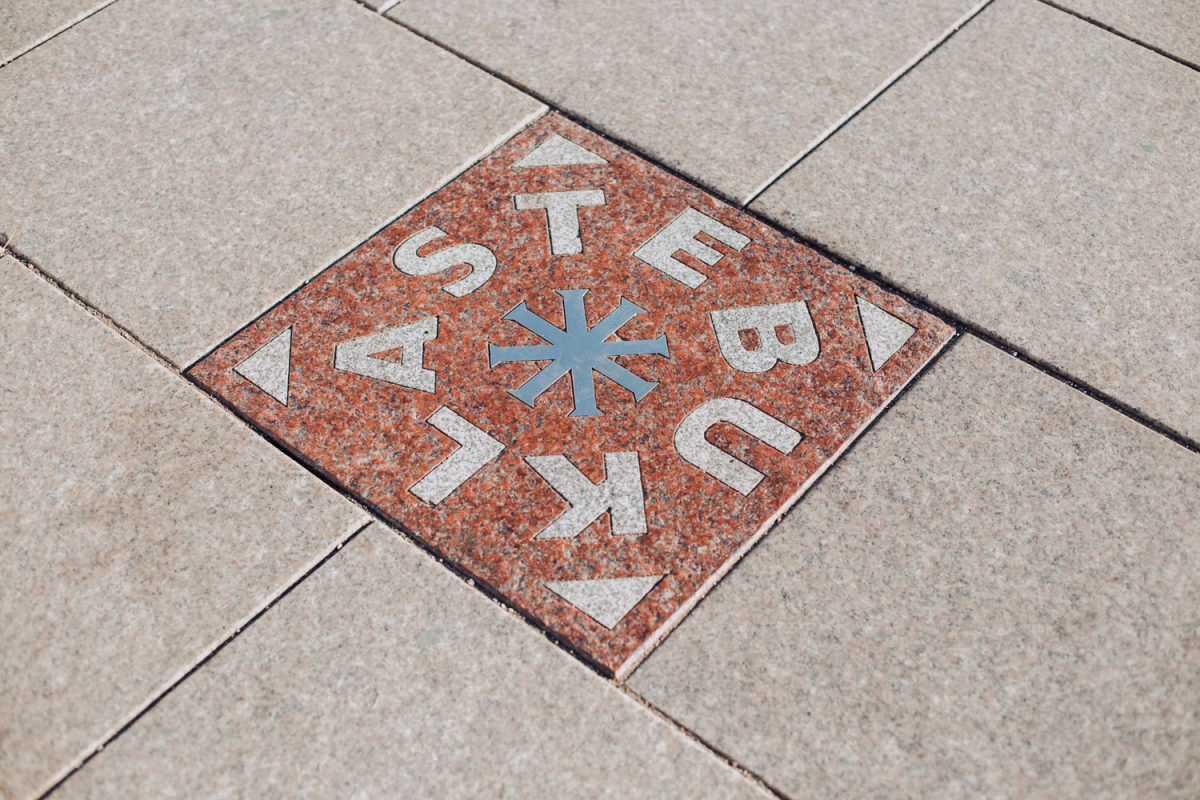 Stebuklas Miracle Tile on the ground in front of the cathedral