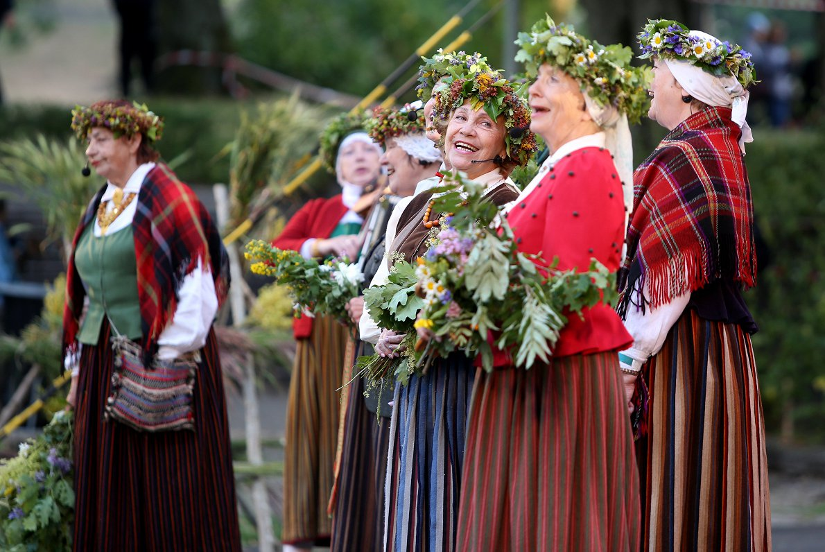 Women in national Latvian dresses celebrating Midsummer Eve in Latvia
