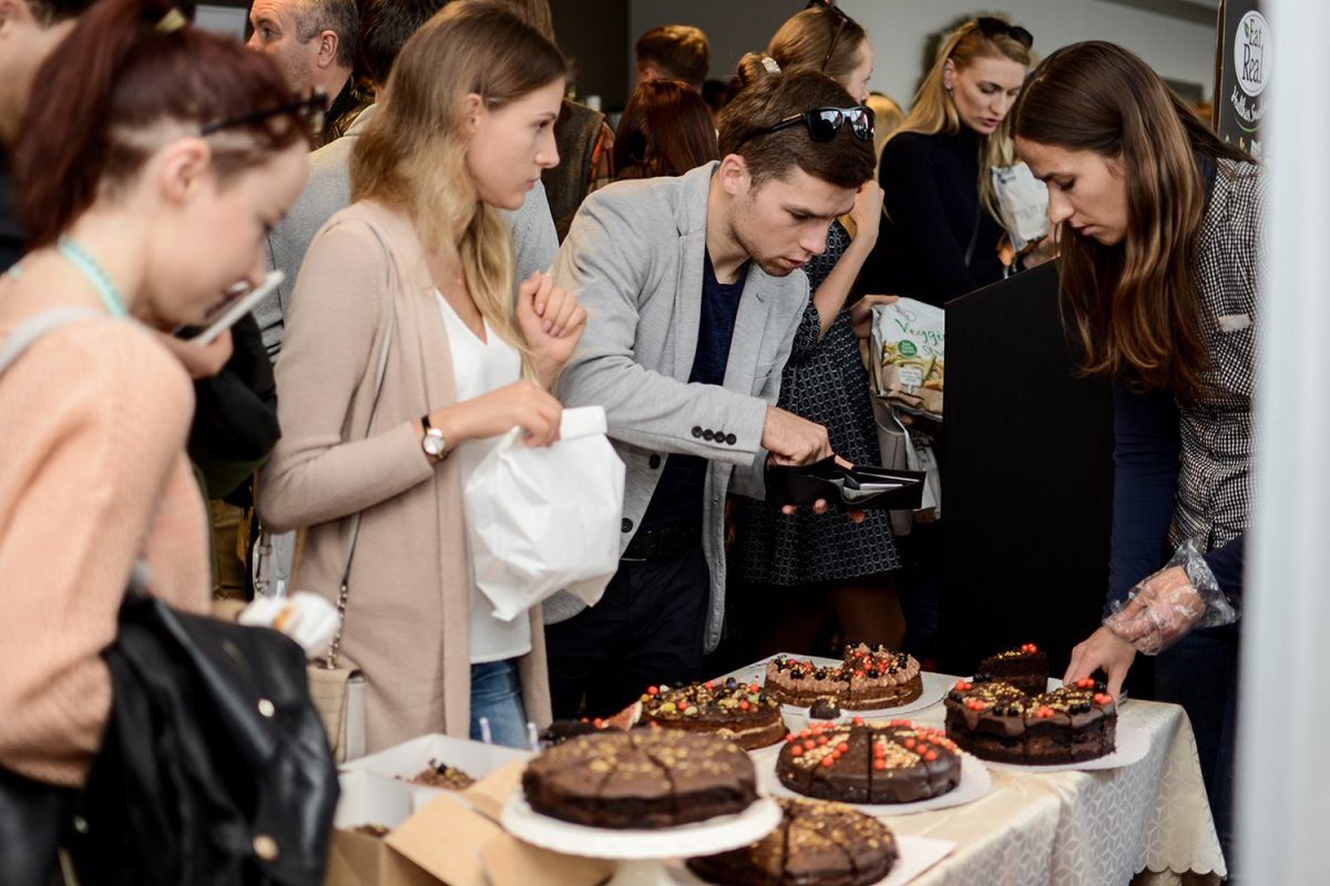 Young man is making photos of cake on VegFest LT 2019 in Vilnius