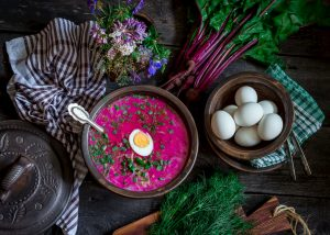 Cold beetroot soup, eggs, nicely served on the table