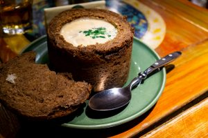 Thick mushroom soup in a loaf of bread